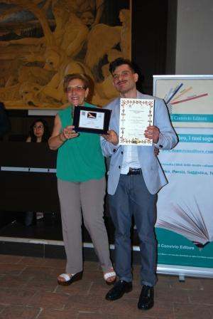 """L'associazione intenazionale """"il convivio"""" ha conferito ad Antonello Pizzimenti una targa da finalista al premio Giuseppe Antonio Borgese in data 15 giugno 2019 nel palazzo della cultura di Catania."""